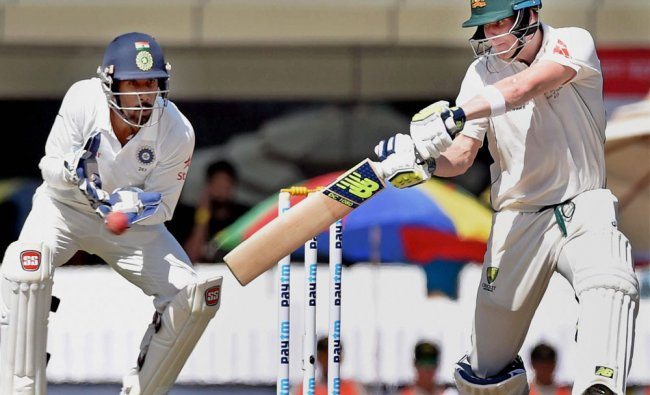 Australian skipper Steve Smith plays a shot during the first day of the 3rd Test against India in ..