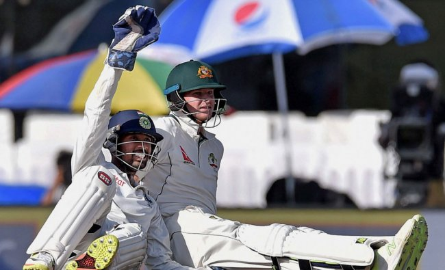 Indian wicketkeeper Wriddhiman Saha appeals after picking the ball from Australian skipper Steve ...