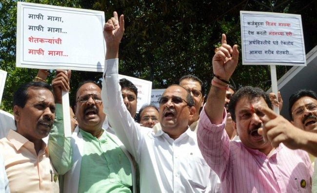 Congress leader Radhakrishna Vikhe Patil (C) and NCP leaders protest against SBI chief Arundhati ...
