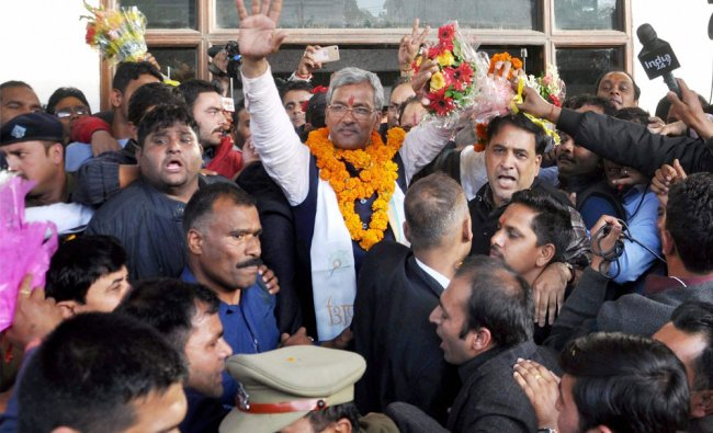 BJP leader Trivendra Singh Rawat being greeted by supporters after he was elected as the party\'s ...