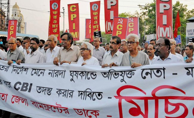 Left Front Chairman Biman Bose and CPI(M) Politburo member and party State Secretary Surya Kanta ...