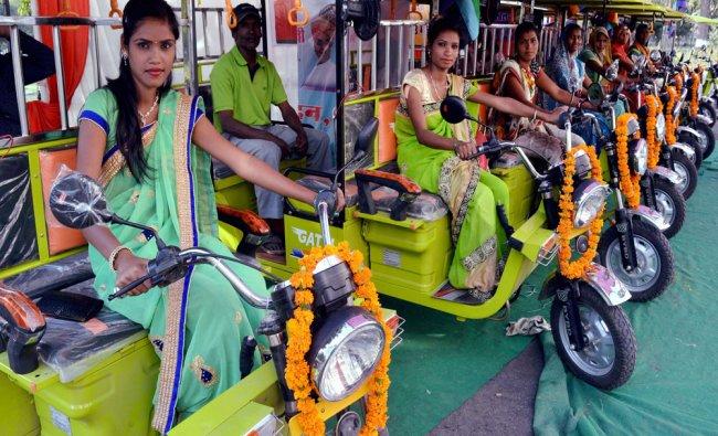 Women pose with E- rickshaw after state government of Madhya Pradeshth provided free e- rickshaw...