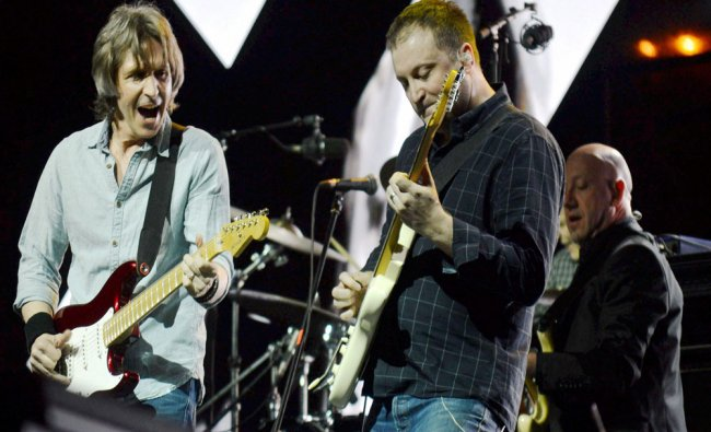 Rock Legend Chris White and Terence Reis of rock band Dire Straits during the live perform at...