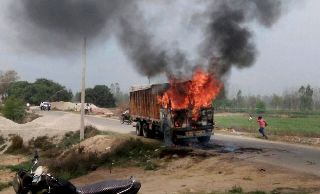 Irate mob set ablaze a truck after it mowed down a child in Moradabad on Sunday...