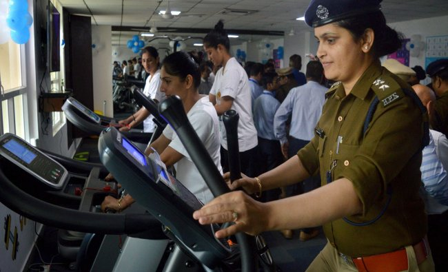 Police officers train at different gym machines in Gurugram on Monday...