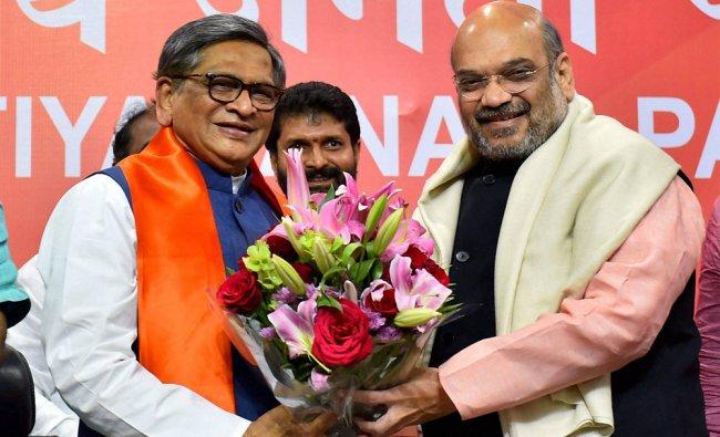 BJP President Amit Shah greets former Karnataka chief minister SM Krishna who joined Bharatiya...