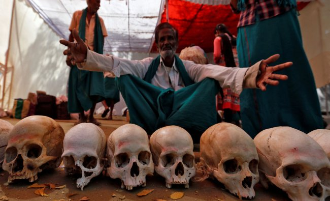 Farmers from the southern state of Tamil Nadu display skulls, who they claim are the remains...