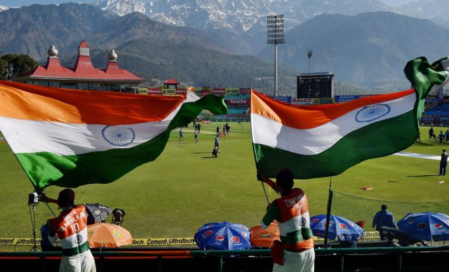 Spirited Indian cricket fans waving the tricolour during the second day of last Test match...