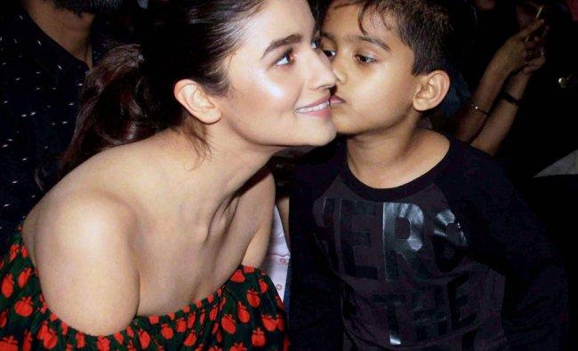Bollywood actor Alia Bhatt visits a dance academy in Mumbai on Saturday...