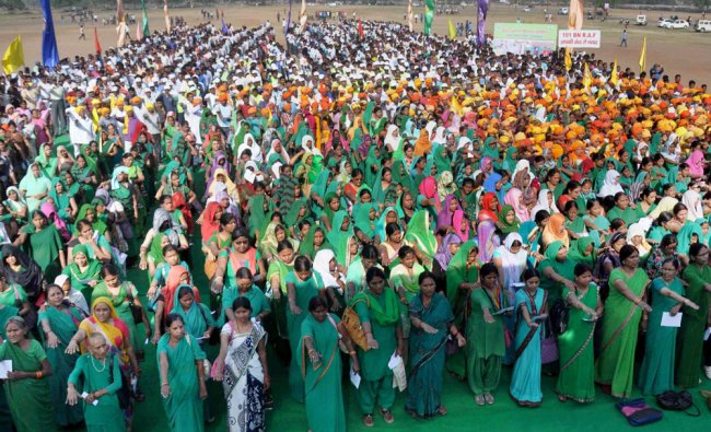 Administrative officers and people together take the oath for National Mission...