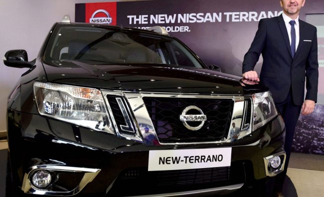 Guillaume Sicard, President, Nissan India Operations poses with the newly launched New Terrano...