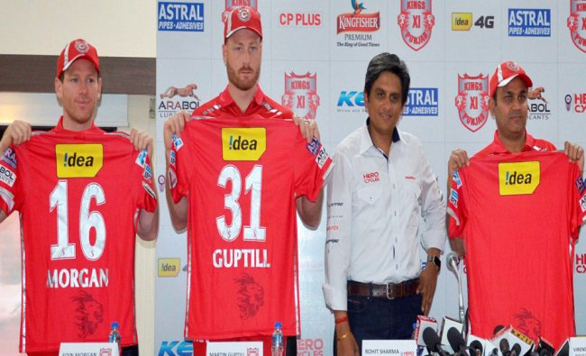 Kings XI Punjab players Eoin Morgan, Martin Guptil and Virendra Sehwag at the launch of their team..