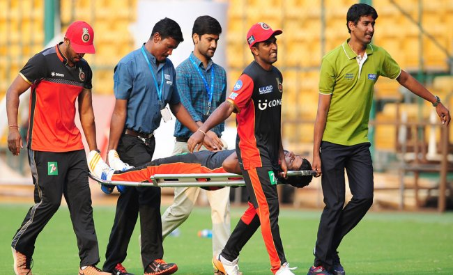 Royal Challengers Bangalore (RCB) player Sarfaraz Khan being taken to hospital after he was ...