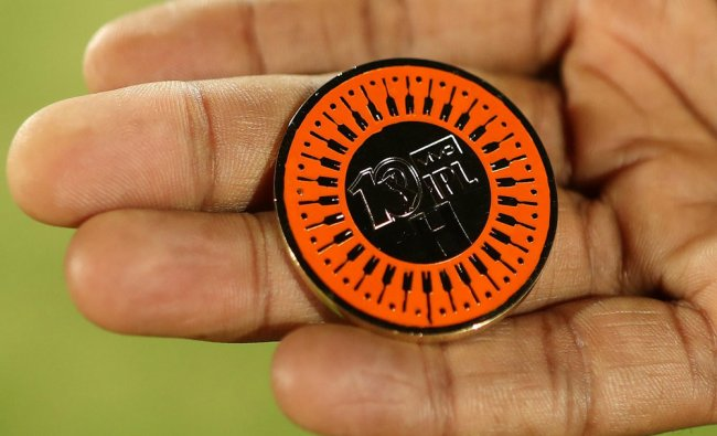 The toss coin to commemorate...