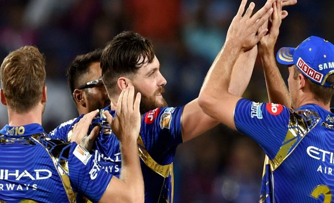 Mumbai Indians bowler Mitchell McClenaghan clelebrates the wicket of Rising Pune...