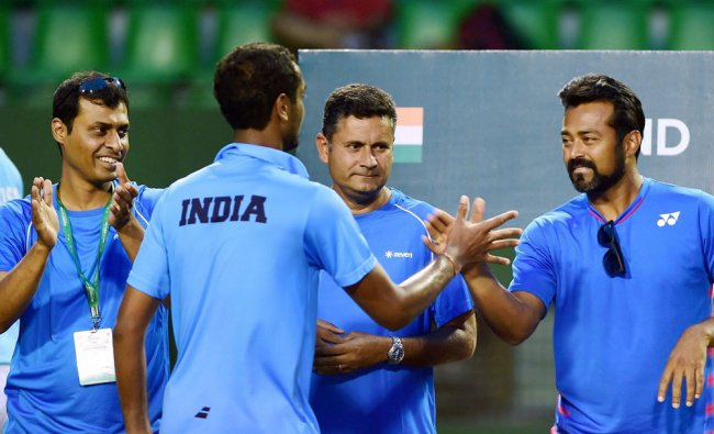 Indian davis cup player Ramkumar Ramnathan being congratulated by Leander Paes and Coach Jeeshan...