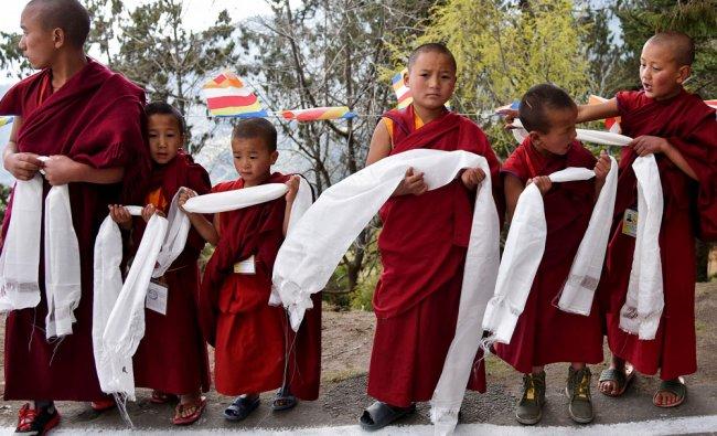 Young monks wait for the arrival of Tibetan spiritual leader Dalai Lama at the Tawang Monastery...