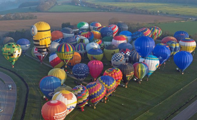 Some of the 100 balloons taking part in a World Record attempt for a mass hot air balloon...