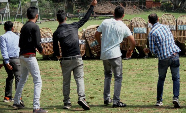 Few youths pelt stones on policemen during a mock drill to handle the stone-pelters in real-life...
