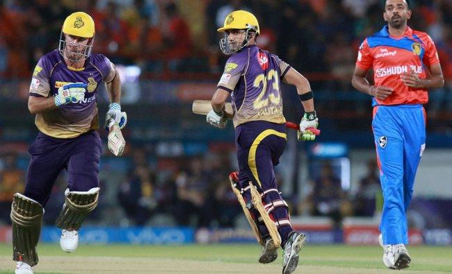 Kolkata Knight Riders captain Gautam Gambhir with Chris Lynn take a run during match 3 of the IPL...