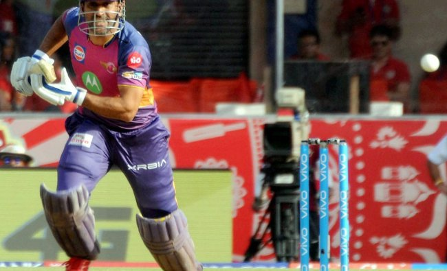 RPS batsman M S Dhoni plays a shot against Kings XI Punjab during an IPL match in Indore....
