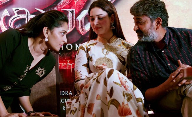 Actor Prabhas with actresses Tamannah Bhatia and Anushka at a press conference to formally launch...