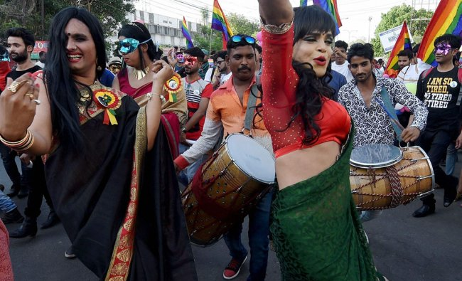 LGBT community members and supporters dance during their Queer Pride March in Lucknow on Sunday...