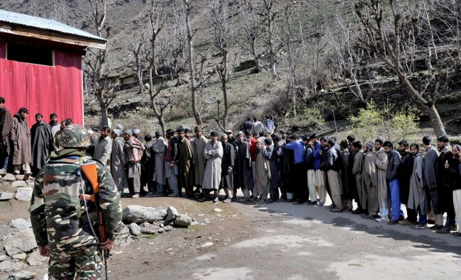 Voters in a long queue to cast their votes during Lok Sabha elections,at a polling booth...