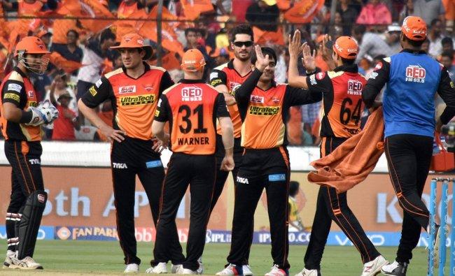 Sunrisers Hyderabad players celebrate the dismissal of a Gujarat Lions batsman during their IPL...