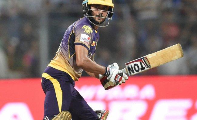 Kolkata Knight Riders batsman Manish Pandey plays a shot during the IPL match against MI...