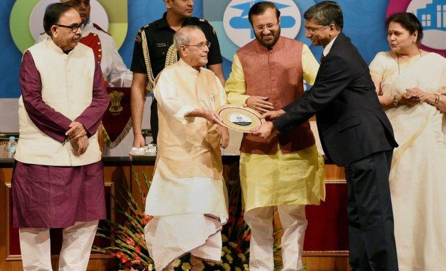 President Pranab Mukherjee with Union HRD Minister Prakash Javadekar presernts award at the NIRF\'s..
