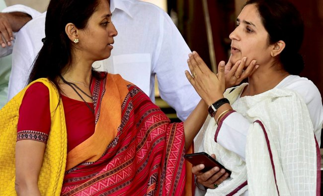 NCP MP Supriya Sule (L) talks with Congress MP Ranjeet Ranjan at Parliament house in New Delhi on...