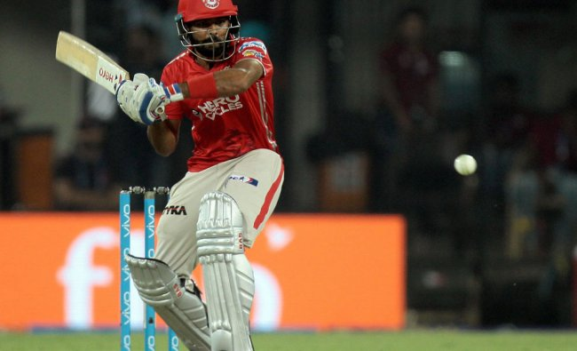 KXIP batsman Manan Vohra plays shot during the IPL 2017 match against RCB at the Holkar Stadium in..