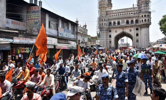 Devotees participating in Hanuman Jayanti rally in old city of Hyderabad on Tuesday...