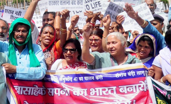 Social activist Medha Patkar along with supporters shouting slogans against the Centre during the...