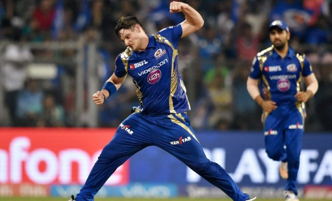 Mumbai Indians\' Mitchell M celebrates the wicket of Shikhar Dhawan during an IPL match against ...