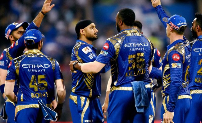 Mumbai Indians\' players celebrate the wicket of David Warner during an IPL match against Sunrisers..