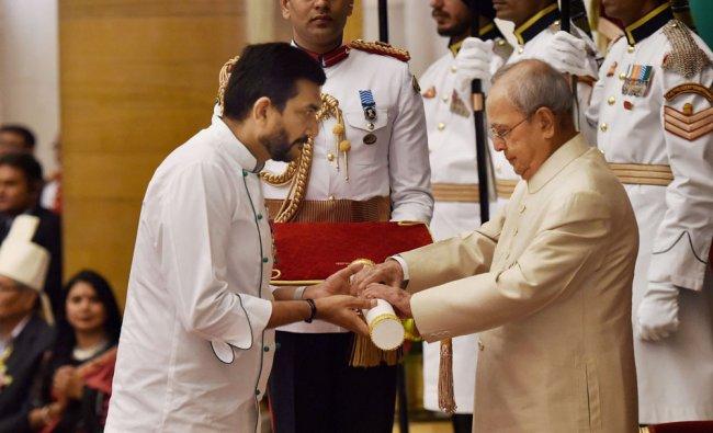 Renowned chef Sanjeev Kapoor receiving Padma Shri award from President Pranab Mukherjee during ...