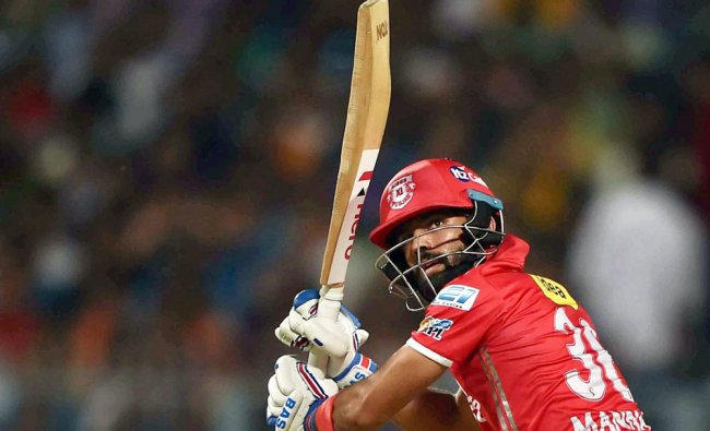 Kings XI Punjab batsman Manan Vohra plays a shot during IPL match against Kolkata Knight Riders ...