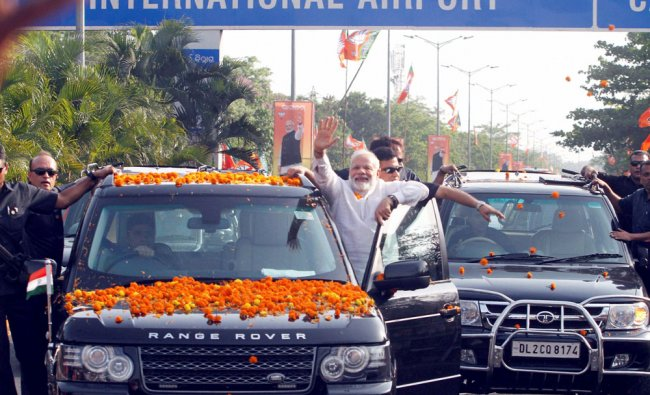 Prime Minister Narendra Modi acknowledges his supporters during a roadshow in Bhubaneswar...
