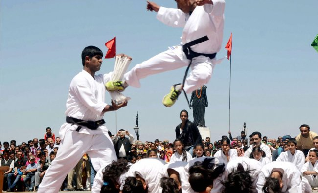 Students perform stunts during Himachal Day celebration at Ridge,in Shimla on Saturday...