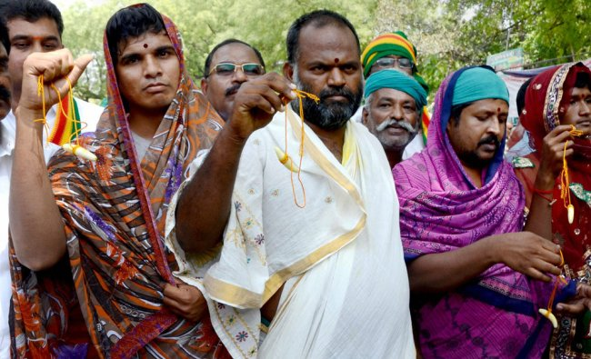 Protesting Tamil Nadu farmers dress as women as they continue with their demand...