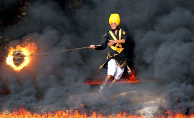 Bir Khalsa Sikh Nihangs group and or warrior performs Gatka martial arts skills...