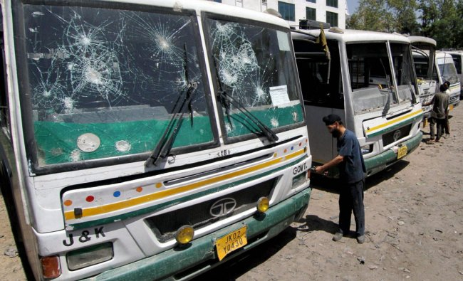 Jammu and Kashmir SRTC buses, damaged by stone pelters in Kashmir, being repaired at a workshop....