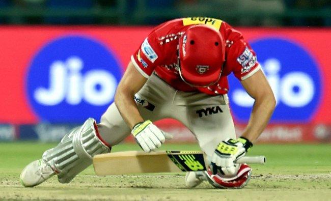KXIP batsman David Miller loses his balance during an IPL match...