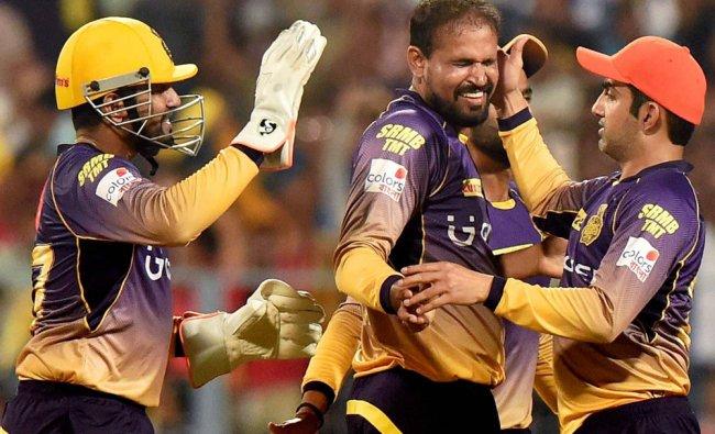 KKR Captain Gautam Gambhir celebrates with teammates after dismissal of Shikhar Dhawan...