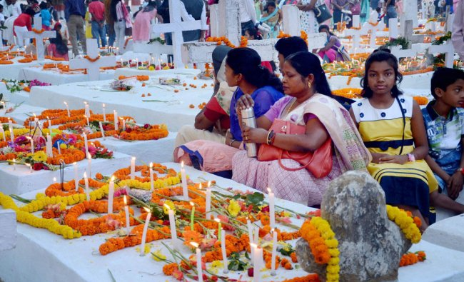 Christian community members light candles at a cemetery to mark Easter, in Ranchi on Sunday...