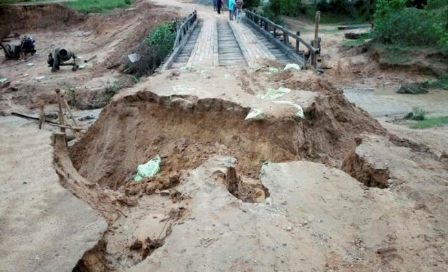 A road caved in after heavy rain accompanied with strong winds lashed parts of the state, in South..