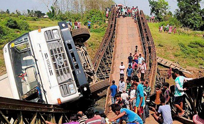 A loaded truck fell into Sarma river after a bridge collapsed at Gandachara Amarpur road, 105 kms ..