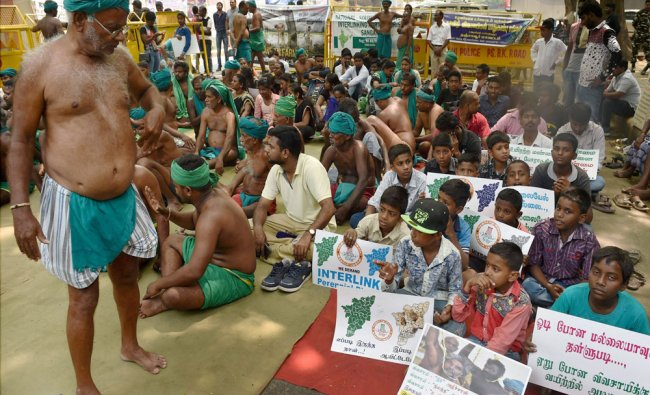 Children support Tamil farmers during their protest demanding loan waiver and compensation for ...